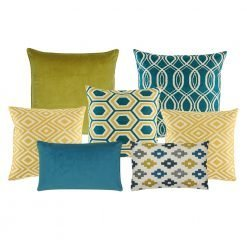 A set of 6 square and rectangular cushion covers in blue and gold colours and with diamond, solid and spiral patterns