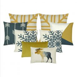 A set of eight gold and blue grey cushion covers in snowflake and moose animal design