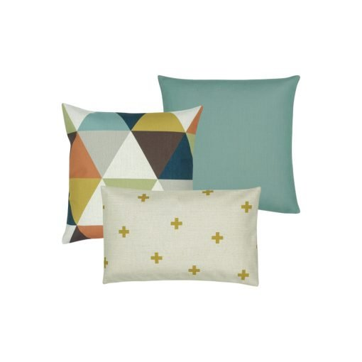 A collection of three cushion covers in teal, gold, grey, orange and brown colours with color blocked, cross and triangle designs