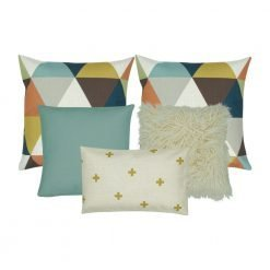 Image of five retro cushion covers with cross and triangle patterns and in square and rectangular shapes