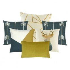 A collection of 6 gold and blue cushion covers in arrow, linear and moose animal prints