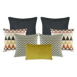 A set of 7 cushion covers with chevron and triangle patterns and in grey and mustard colours