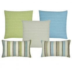 A collection of square and rectangular cushions in cable knit and line patterns
