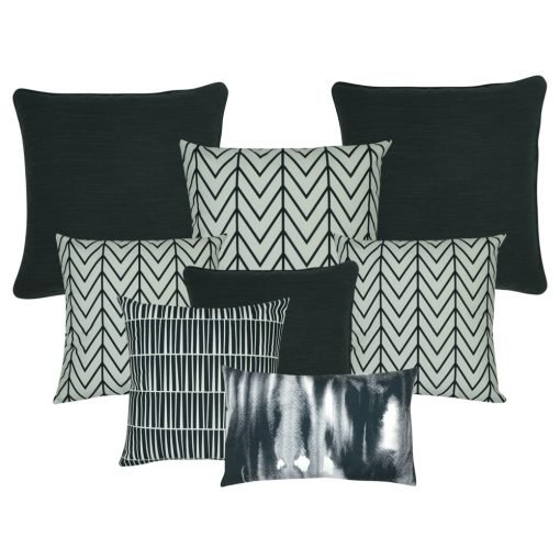 A collection of 8 cushion covers with black, grey and white colours