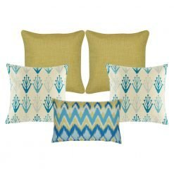 A set of 5 cushions with solid, modern floral and chevron patterns and in gold and blue colours