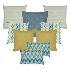 A set of 7 cushions covers with solid, modern, cable knit and chevron patterns and in gold and blue colours