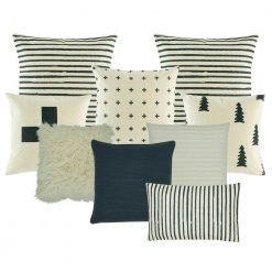 Image of nine cushions with stripes, cross, tree designs