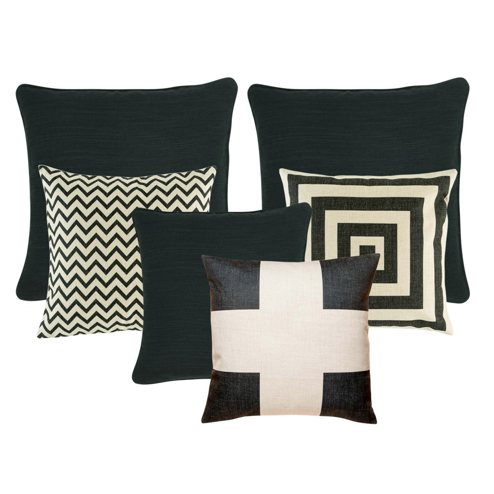 A set of black and white cushions with square, chevron and cross patterns