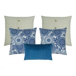 A collection of 5 square blue and white cushions in solid, floral and cable knit patterns