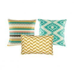 A collection of 3 cushions with geometric designs in blue and gold colours