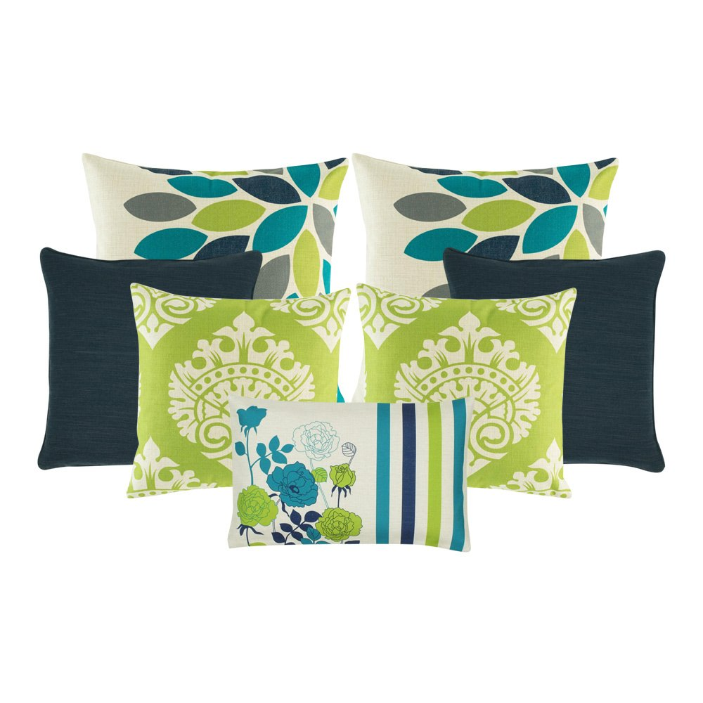 A set of 7 cushion covers in lime and teal colours with floral designs