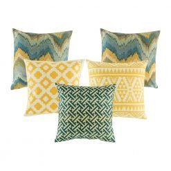 A collection of 5 cushions with blue and gold colours with abstract and diamond patterns