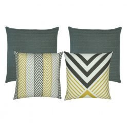 A mix of four square cushions in grey and gold colours with arrow patterns