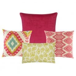 A set of 4 cushions with leaf and diamond patterns and in yellow and fuchsia colours