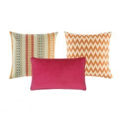 A set of 3 cushions with solid, line and chevron patterns and in orange, fuchsia and multi colours