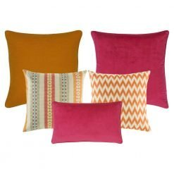 A collection of 5 cushion covers with solid, line and chevron patterns and in burnt orange, fuchsia and multi colours