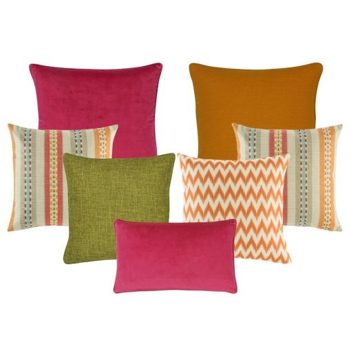 A mix of rectangular and square cushions with orange, green and fuchsia colours in solid, chevron and stripe designs