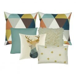 A collection of six cushions in teal, gold and white colours in triangle and moose design