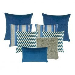 A set of 8 blue and grey square and rectangular cushion covers with zigzag, line and solid patterns