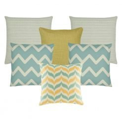 A set of 6 cushions in gold and teal colours with chevron and solid patterns