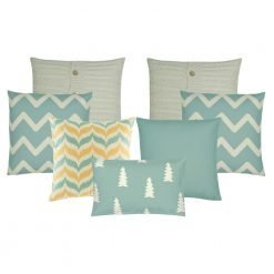A set of 7 cushion covers in gold, white and teal colours with chevron, pine and cable knit patterns