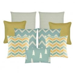 A set of 9 cushion covers in gold and teal colours with solid and pine patterns
