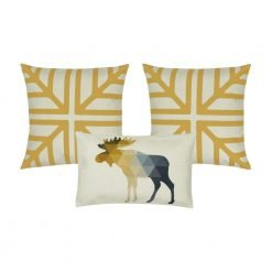 A photo of three cushion covers in gold and white colours