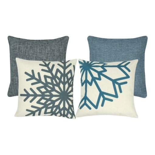 A mix of four square blue and grey cushions with snowflake patterns