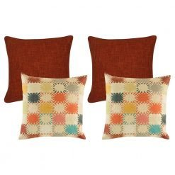 A collection of 4 square cushions with burnt orange base colour