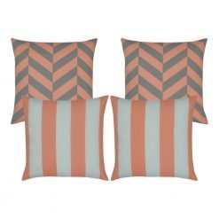 Set of four outdoor cushions with two peach and grey chevron designs and two peach pink and white stripe cushion covers in the front