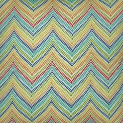 Close up photo of colourful outdoor cushion cover in zigzag pattern