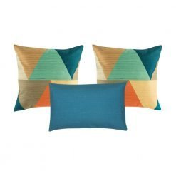 A set of 3 square and rectangular blue cushions with triangle patterns