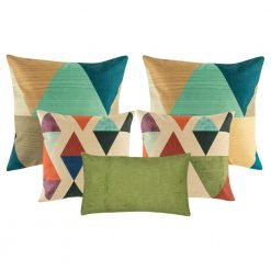 A mix of square and rectangular cushions with diamond and triangle patterns with tones of green blue teal and brown