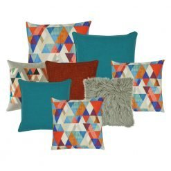 A collection of 8 square cushions with red, blue and grey tones and triangle patterns
