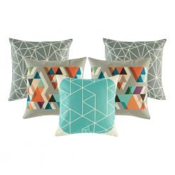 A mix of 5 square teal and grey cushions with triangle patterns