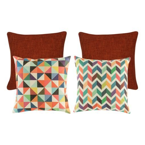 A set of 4 rainbow and red cushions with diamond and chevron patterns