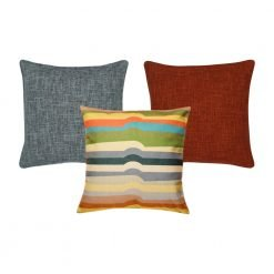 A set of multi-coloured, burnt orange and grey square cushions