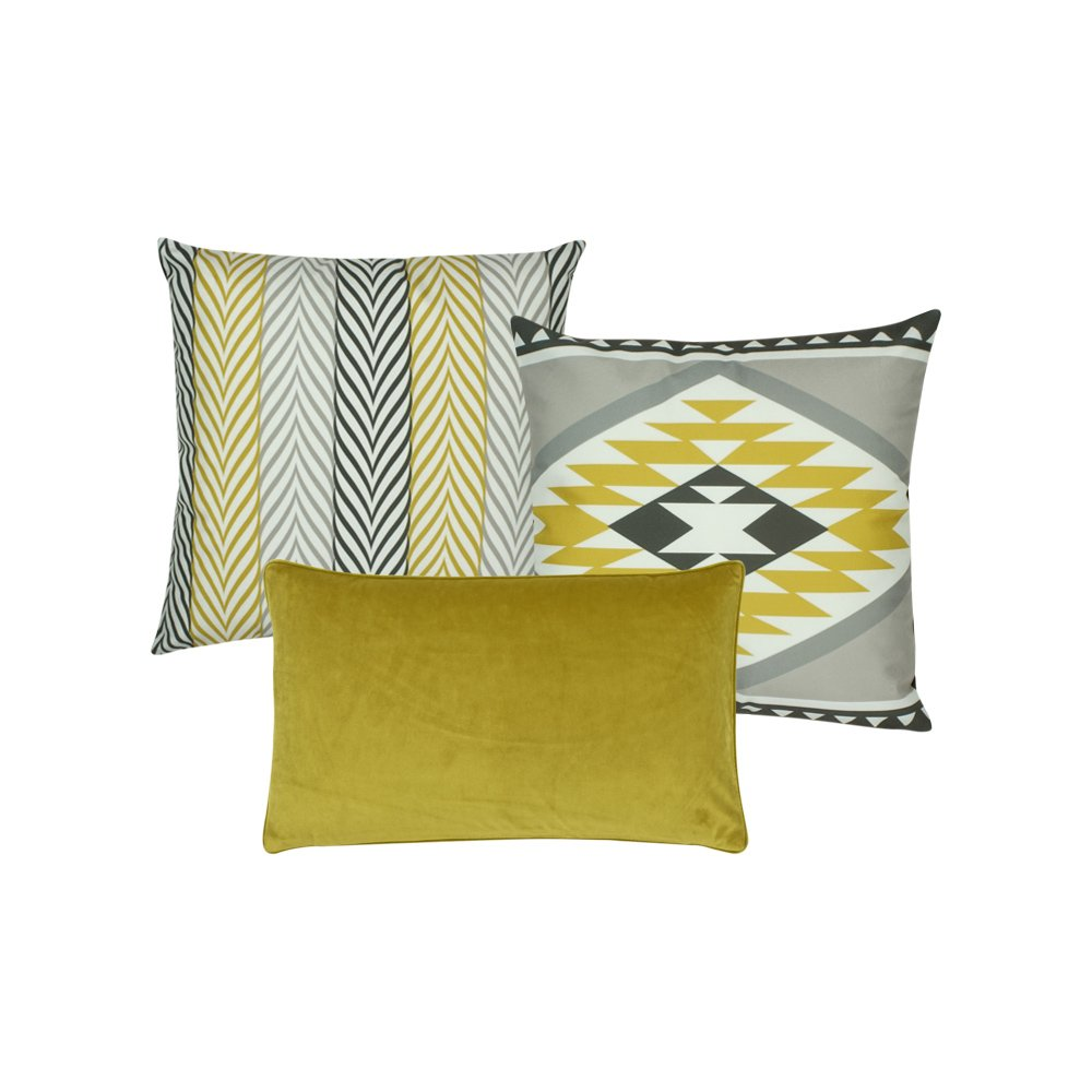 A collection of 3 gold and grey cushions with aztec tribal patterns