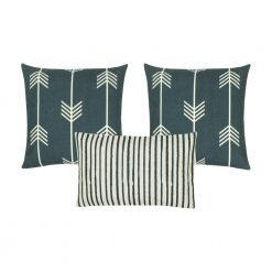 A photo of three cushion covers with arrow and stripes design, in white and grey colours