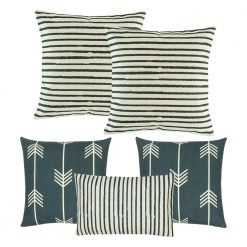 A collection of 5 square and rectangular cushions with stripes and arrow designs