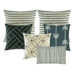 A set of 6 cushions in navy and neutral colours with stripes, arrows and circle patterns