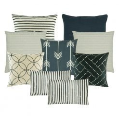 A collection of 9 black, white, navy cushions in stripes, circle, line patterns