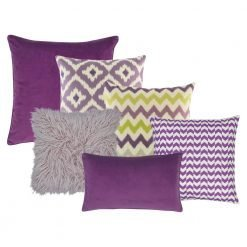 A collection of 6 cushion covers with lilac, plum and lime colour and in diamond and chevron designs