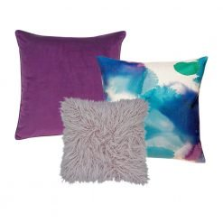 A set of 3 square cushions in plum purple and lilac colours