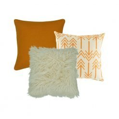 A collection of 3 cushion covers in orange and white colours and arrow pattern