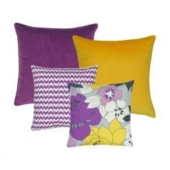 A photo of 4 square cushions with floral and purple chevron designs