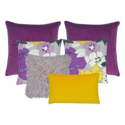 A collection of 6 purple and yellow cushion covers with floral design