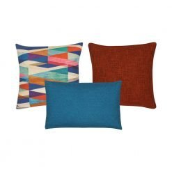 A set of 3 multi-coloured, burnt orange and blue cushion covers