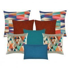 A set of 8 cushions with burnt orange, grey, blue and teal colours and with diamond patterns