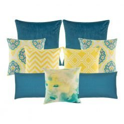 A mix of square and rectangular cushions with blue and yellow colours and diamond and zigzag patterns